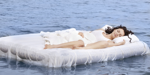 Woman sleeping on the bed in the sea